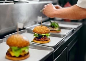 Burger Restaurant. Closeup Chef Cooking Burgers In Kitchen.